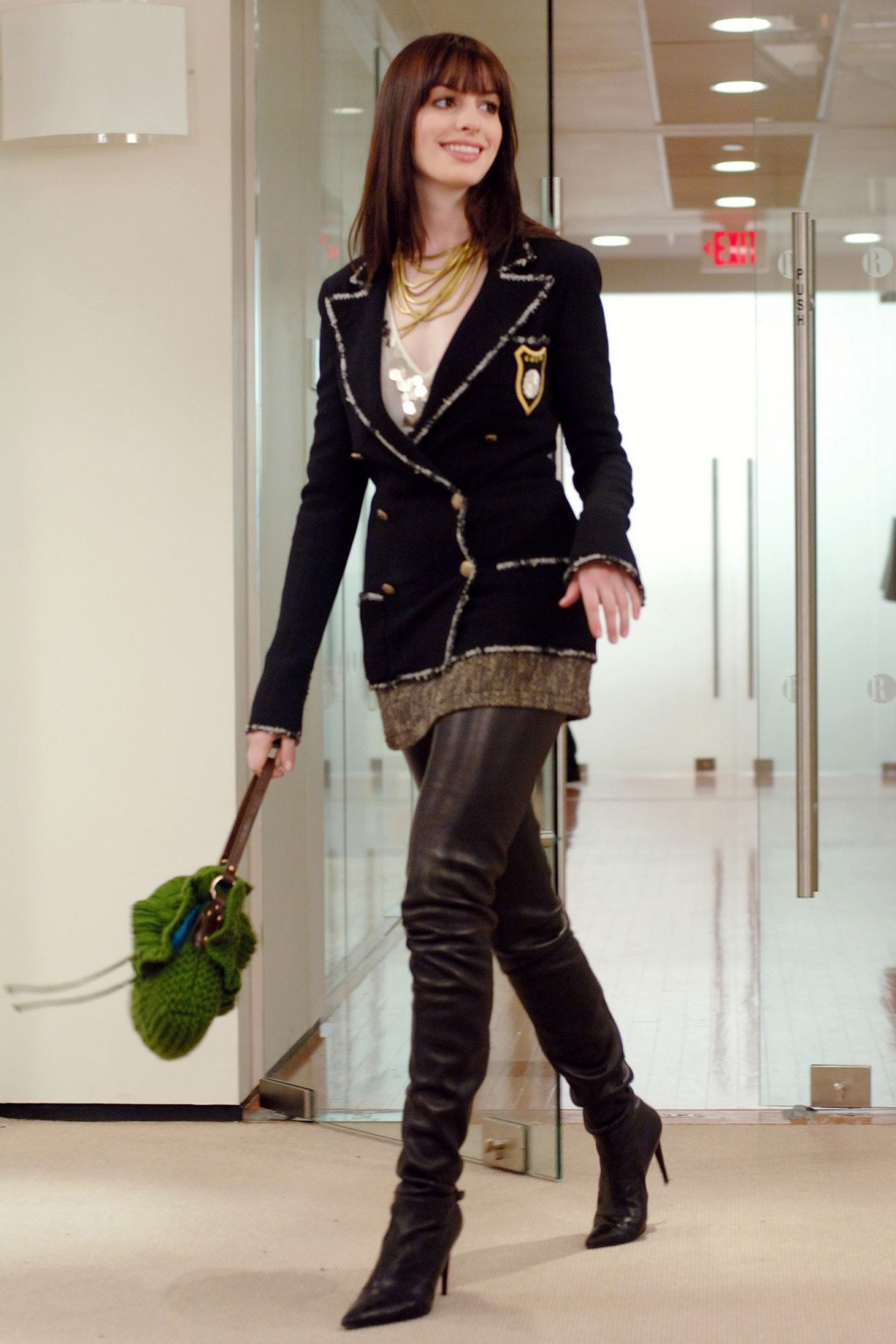 DWP-96 Andy's (Anne Hathaway) outfit features a black wool crepe Chanel jacket; Kristina Ti brown tweed mini-skirt; ecru vertical striped gauze deep v-neck blouse; black leather thigh high boots; an antique gold necklace and black leather Chanel gloves. PHOTOGRAPHS TO BE USED SOLELY FOR ADVERTISING, PROMOTION, PUBLICITY OR REVIEWS OF THIS SPECIFIC MOTION PICTURE AND TO REMAIN THE PROPERTY OF THE STUDIO. NOT FOR SALE OR REDISTRIBUTION.